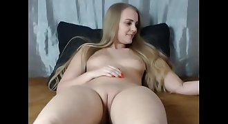 Sexy Young Blonde Shows Off her Shaved Pussy on Webcam - CamGirlsUntamed.com
